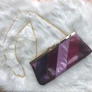 ALDO purple snakeskin look clutch with gold strap